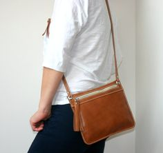 Simple and nice leather crossbody bag with leather tassel zipper puller. I made it from premium quality vegetable tanned caramel colour leather. YKK