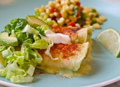My whole family loves these enchiladas filled with smoky shredded chicken and cheddar cheese in a tangy tomatillo sauce. They're lighter and fresher than the enchiladas served in most Mexican restaurants, especially when you top them with crisp shredded romaine, sour cream and sliced avocado. I'll be honest, they take a bit of time to make