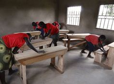 Project Gulu, Uganda - Right after the last batch of really nice new desks were made, the children wanted to sand them, to get them ready for varnishing after exams finish this week. — An Activated Ministries project