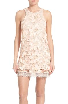 An overlay of delicate openwork lace sweetens this flirtatious shift dress tailored with cool cutaway shoulders and a leg-flaunting hem.