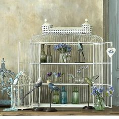 Vintage shelved birdcage cabinet  This wonderful vintage-style shelved cabinet, in antiqued off-white, makes an unusual storage cabinet for glassware or is a great place to display all your treasures, books and precious artefacts. Play to your hearts content to create an unusual floral or plant display in a conservatory.