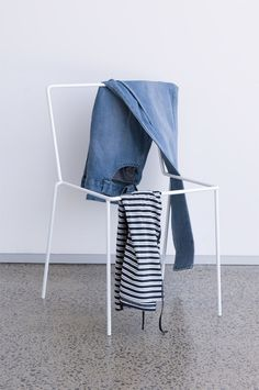 I love this. I HAVE to get one of these for my husband since he uses more than one chair in our house to hang his clothes on and SO we can never sit on them.
