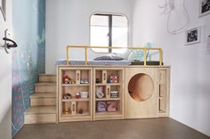 HAO Design have created a child's bedroom with a custom bed that's been designed to get the child familiary with putting things away after using them. #KidsBed #BedDesign #Bedroom