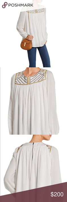 """PAUL & JOE Rosier embroidered muslin top Details & Fit White muslin Zip fastening along back 100% viscose; embroidery: 100% polyester; lining: 100% viscose Dry clean  Size 4 = L-XL Fits true to size, take your normal size Cut for a loose fit Lightweight, non-stretchy fabric Those with a petite frame may wish to take the next size down Model is 177cm/ 5'10"""" and is wearing a size 1 Paul & Joe Tops Tees - Long Sleeve"""