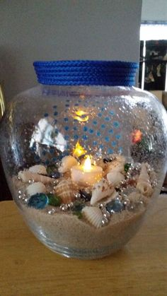 Wanted a soft beach light poolside. Easy 20 minute craft.[media_id:3396247]Got cracked glass vase from Habitat cost $1.50.[media_id:3396250]Punched out dots…