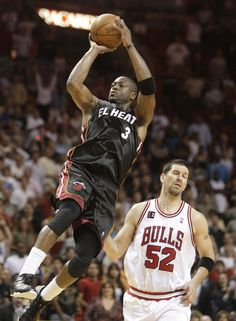 Yes, that is Dwayne Wade with his feet at a 6'5 man's waist.