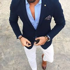 Pairing a dark blue sport coat with white casual trousers is an on-point option for a day in the office. A cool pair of brown leather double monks is an easy way to upgrade your look. Shop this look on Lookastic: https://lookastic.com/men/looks/blazer-long-sleeve-shirt-chinos/21048 — Light Blue Long Sleeve Shirt — Navy Blazer — Navy Paisley Pocket Square — Dark Brown Leather Watch — Dark Brown Leather Bracelet — Dark Brown Leather Belt — White Chinos — Brown Leather Double Monks