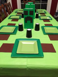 Minecraft birthday party on a budget! Party city square plates & napkins, cut cardstock glued to paper bags for creepers