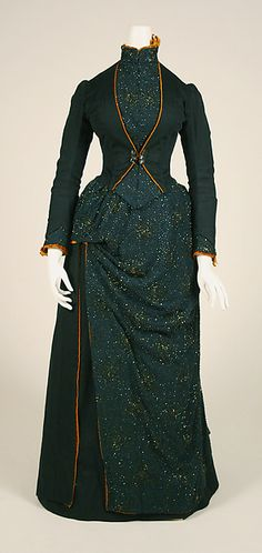 Ensemble, c. 1887; American; wool, silk, glass, feathers. The pattern is entirely worked in beads!