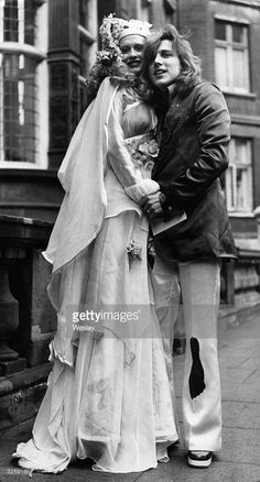 The colourful bride, Firefly, superstar model of the seventies, with her groom, Mike Taylor, who is wearing a green and wine-coloured suit, after the ceremony.
