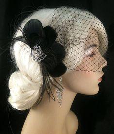 Bridal Feather Fascinator with Brooch, Bridal Fascinator, Fascinator, Bridal Veil, Black Peacock, Black Goose. $68.00, via Etsy.