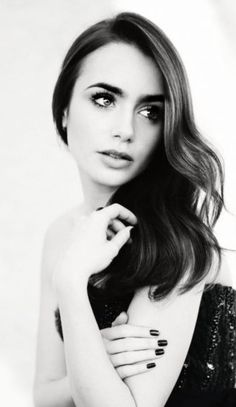 Lily Collins-I think she is very pretty....so I instanly dont like her haha. Jealousy is an ugly thing lol (im joking by the way)