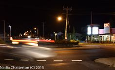 L1M2AP3- Aperture Priority Motion Blur- This shot is handheld, however I did use a slower shutter speed and it appeared to work for me! In my example of motion blur I captured the tail lights of a car driving around a round-a-bout near KFC. Cropped in Light room Nikon D5500 .62sec  f/4.2 ISO-200