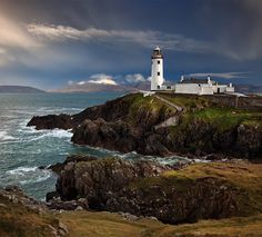 Rainy days at Fanad Head Lighthouse. Umbrella blew inside out trying to get this one, hint of a rainbow there. Such is the Irish weather. Irish Weather, Irish Landscape, Lighthouse Keeper, Explore Travel, Donegal, Earth Science, Ireland Travel, Emerson, Amazing Photography