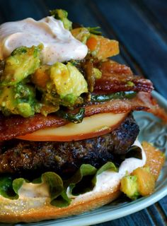 Spicy Colossal Cheeseburger with Brown Sugar Jalapeno Bacon, Smoked Gouda, Melon Avocado Chutney, and Chipotle Mayo - from The Lazy Mom's Cooking Blog
