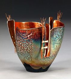 Clay and fiber art by Marc Jenesel :: Copper sand Raku, copper, walnut, mica