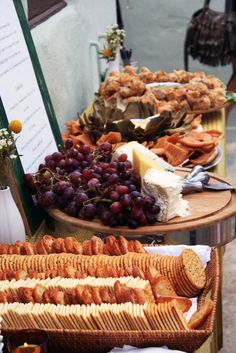 Crackers, fruit, and cheese while guests wait for photos/bride and groom to arrive. This looks too delicious, I'd probably sneak away from taking photos just to grab a plate. Or 3.