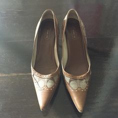 "Coach Evonne Pump in khaki and tan/brown size 7.5 Pointy Coach pump with wooden kitten heel. Coach ""CC"" pattern with leather detail at toe & heel. Gold stud detail. Made in Italy. No box Coach Shoes"