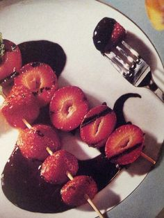 Champagne dipped strawberry brochettes over chocolate sauce