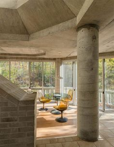 Pillars and other raw construction elements are exposed throughout the space.