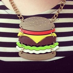 Zoe is the Hamburgler's twin today in a stripy top, pinafore and Super Burger Necklace! Take a bite now: http://www.tattydevine.com/super-burger-necklace.html