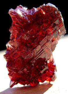Deep red Spessartite Garnet Crystal from Navegador mine Brazil Photo: GoldenHourMinerals
