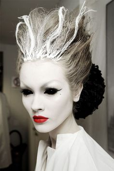 Be the Ice Queen with this mystical looking makeup. Paint your face off white along with the eyebrows and use bright red lipstick to make your lips stand out. Enhance the ghastly effect with black sclera lenses.