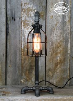 Steampunk Industrial Machine Age Lamp Add the perfect touch of steampunk style to any space with this unique lamp post style industrial table lamp! Crafted from a blend of electrical and plumbing comp