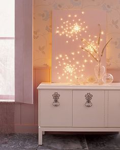 How To Make A Glittering Lightscape - Create a beautiful landscape with a stretch canvas and small Christmas lights.