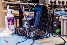 Essentials on every engineer's workbench: fume extractor, decent soldering station, automated flux dispenser and chemical solvents for cleaning the mess you make.