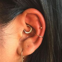 A daith (here) or rook piercing tends to be easier to care for, since it's tucked into the ear and less susceptible to being bumped or pulled.  #refinery29 http://www.refinery29.com/2016/10/126285/body-piercing-constellation-la-trend-photos#slide-17
