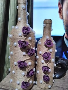 Cord wrapped bottle with purple flowers