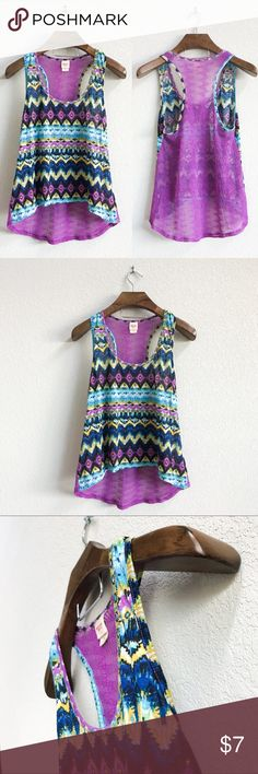 Aztec Mesh Back Racerback Tank Pre-loved but still in good condition. Minor signs of wear, see pics, but no stains, major snags, or tears. (0288)   PRODUCT DETAILS: •Size: Extra Large •Colors: Purple, Blue, Yellow, Green, White •Made in China •Measurements: Chest-18inch Length-25inch •Mesh Back •Racerback •100% Polyester •Machine Wash •Cool Tone Aztec Print  Tags: shirt blouse top summer beach chevron Mossimo Supply Co Tops Tank Tops
