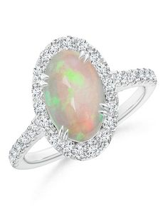 Secured Claw Cabochon Opal and Diamond Halo Ring