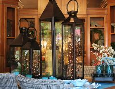 Lighted twigs in lanterns are perfect for an outdoor entertaining area.