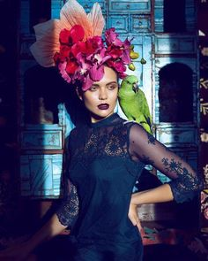 Winter palette and millinery inspiration all in one photograph! Perfection!  I absolutely love this photograph the headwear is stunning and the addition of the stunning green parrot balances the brightness of the millinery with the richness of the indigo dress and dark plum lip! I have tried yet I can't seem to find any details of the creative souls involved in pulling this shoot together but I will keep looking because I want to work with them all at some point in my career..