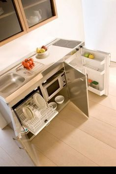 Dishwasher under sink/ open shelving space under counter for microwave, cook books, etc.