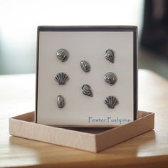 Seashells Pushpins from LapelPinPlanet.com.  8 pieces per set, hand cast in fine, lead free pewter by our family in Coventry, RI.  Great for hanging beach pictures, recipes, and any ocean décor.