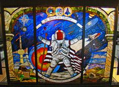 Stained Glass Memorial, on display inside the Kansas Cosmosphere, Hutchinson. The memorial is a tribute to those astronauts who lost their lives on the three mission disasters (Apollo I, Challenger, and Columbia). Photo by John Roever.