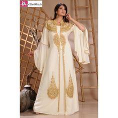 Cette robe de Dubaï de couleur blanc ivoire est magnifique de par sa broderie de perles dorées et son design élégant vendu pas cher sur ethnikka elle fera de vous une princesse lors de vos soiréessur ethnikka.fr
