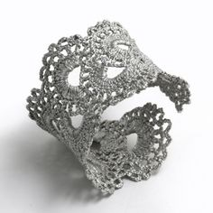 make a cuff bracelet with lace and fabric stiffener.