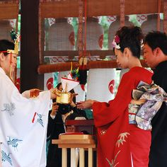 In the beloved Japanese tradition of san-san-kudo, the bride and groom take three sips each from three flat sake cups, after which their parents do the same, bonding the families together