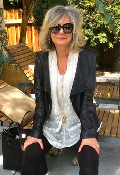 Gracefully growing out gray hair. I think she looks fabulous and love her unique sense of style! #ageless #beauty