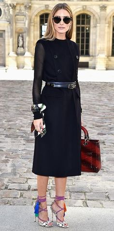 The style star sat perched in the front row of the Dior spring/summer 2015 show during Paris Fashion Week in a black double-face wool Dior coat dress (with sheer sleeves) that she belted at the waist, accessorizing with a printed Dior scarf bracelet, Dior sunnies, a red Dior croc handbag, and lace-up tasseled Jimmy Choo heels.