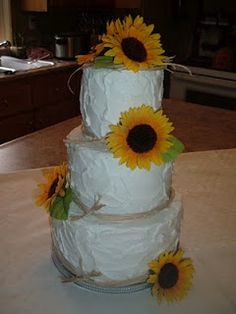 cake, but not with sunflowers. and only one or two layers (cupcakes for the main cake)