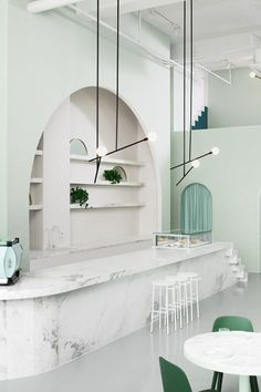 The green-toned interior design of the Budapest Café in Chengdu, China, by Biasol Studio is inspired by the style of director Wes Anderson. Grand Hotel Budapest, Budapest Cafe, Arch Interior, Cafe Interior Design, Cafe Design, Home Interior, Interior Architecture, Minimalist Architecture, Scandinavian Interior