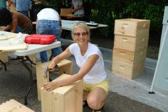 Putting together hive boxes to donate to novice beekeepers.