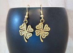 Gold Shamrock Earrings - Gold Four Leaf Clover Earrings - Shamrock Dangle Earrings - St. Patrick's Earrings - St. Patty's Jewelry - Gift by SerenityoftheSouth on Etsy #gold #shamrock #earrins #stPattys