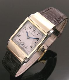 A rare gold and steel rectangular hooded lug vintage Rolex watch, 1930s