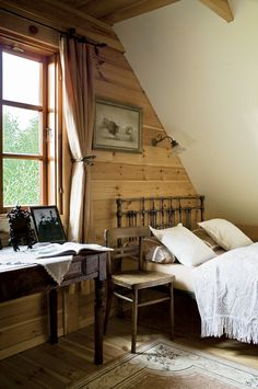 Rejuvenation UrbanFarmhouse: lovely rustic bedroom-raw pine boards work for texture here mixed with the vintage pieces